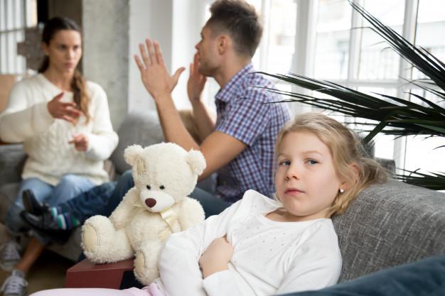 little-upset-girl-daughter-depressed-with-parents-arguments-divorce_1163-4845