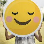 person-holding-yellow-smiley-round-plate-thumbnail
